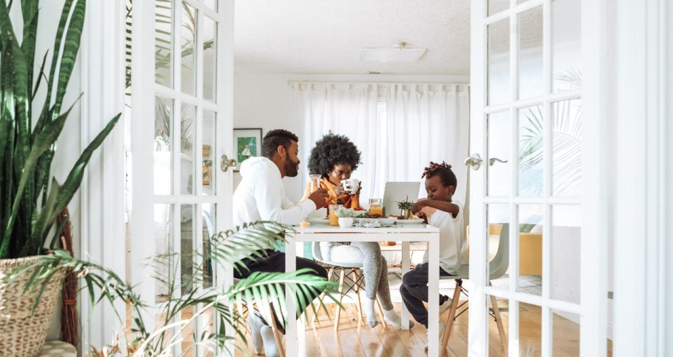 Picture of a family eating at a table in their family home
