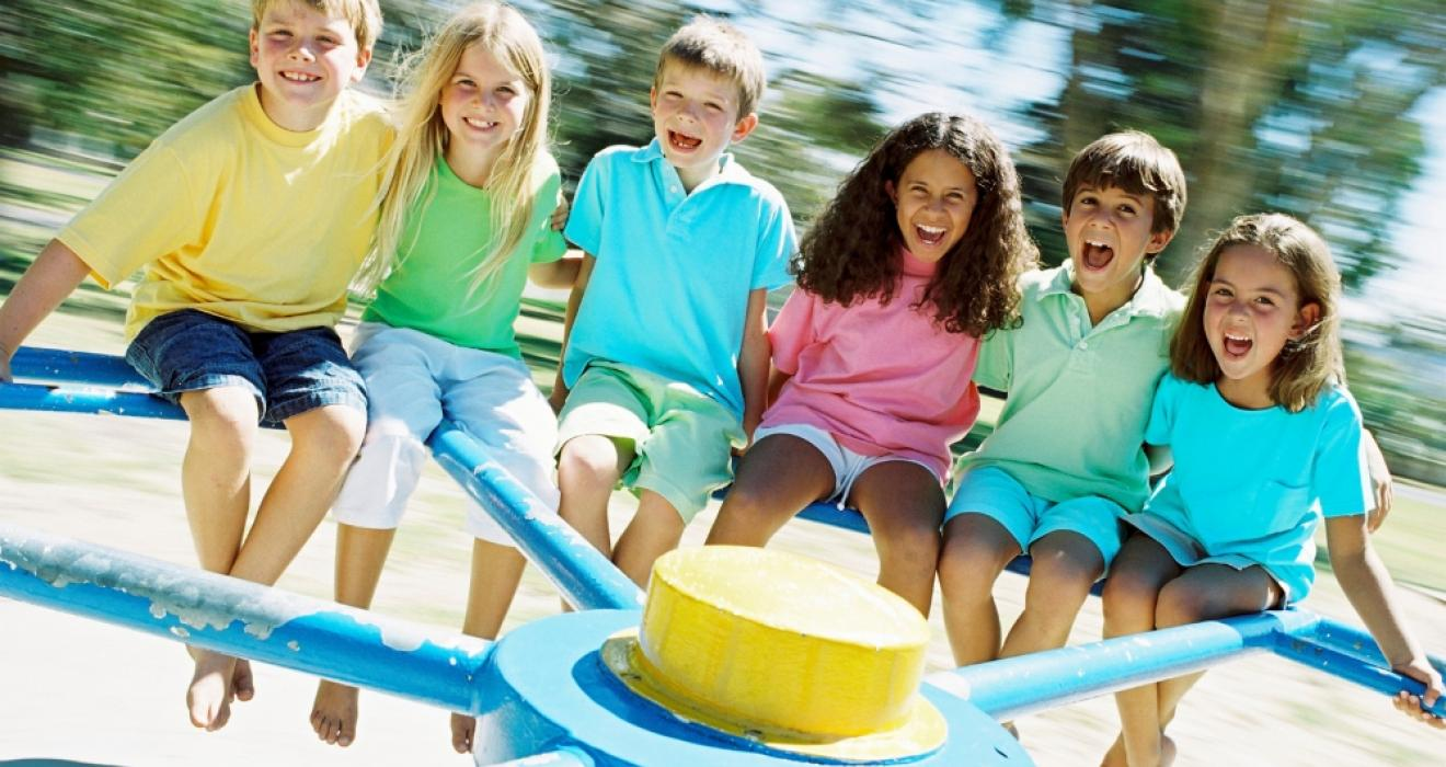 picture of children playing in a park in the sunshine