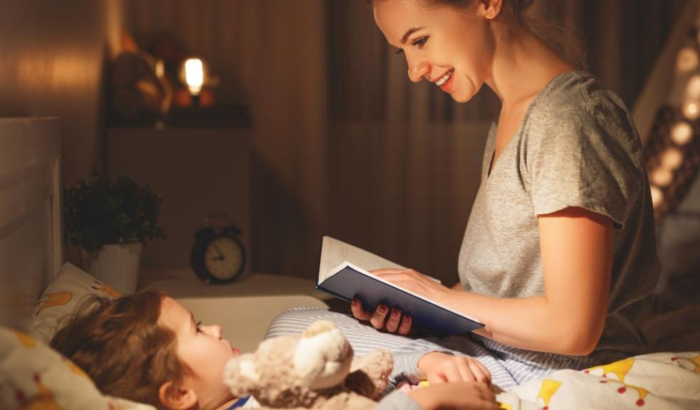 Picture of a mum reading her child a bedtime story
