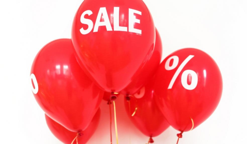 Picture of red balloons with sale written on one of them