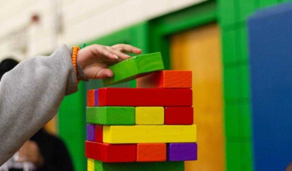 Picture of some blocks being stacked on top of each other in the olympic colours