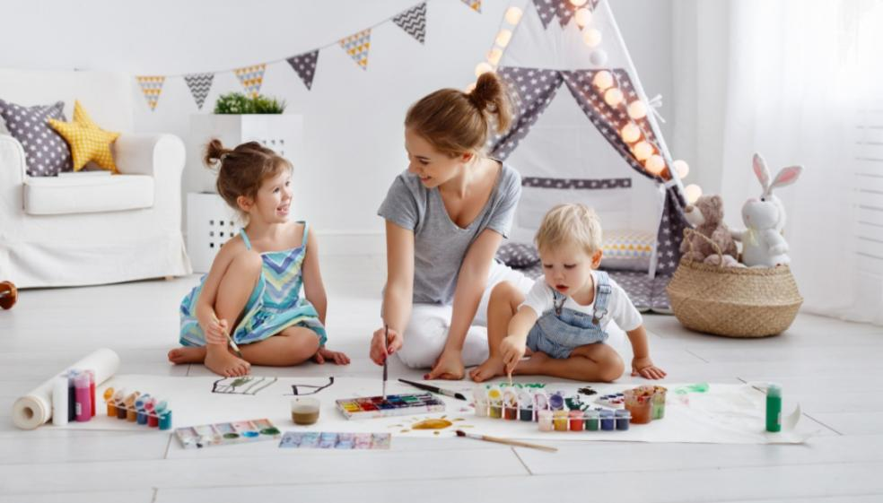 Picture of a mum painting with her children