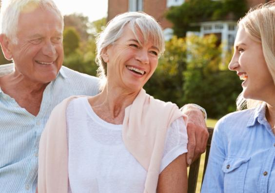 Picture of adult child at home with her elderly parents