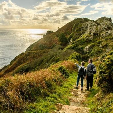 Picture of a family walking on a cliff path in Guernsey