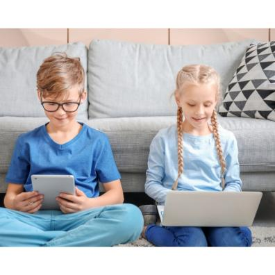 Picture of a boy and girl on an tablet and laptop