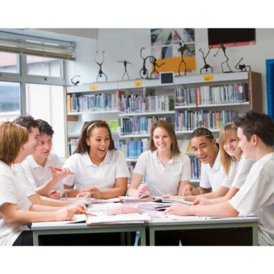 Group of teenagers working and laughing together in a school library