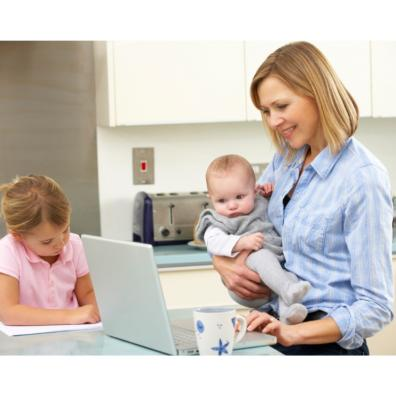Picture of a mum on a laptop with her children in the kitchen