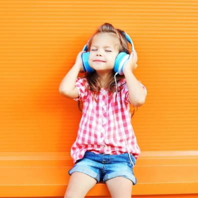 Picture of a happy child listening to headphones