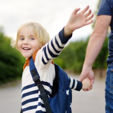 Picture of a child smiling on his way to school