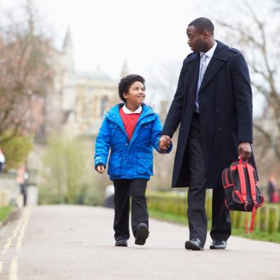 Picture of a father walking his son to school