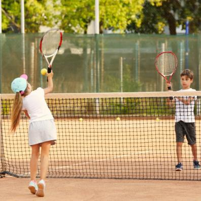 Picture of children playing tennis on a tennis court