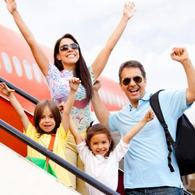 Picture of excited family getting on a aeroplane to go on holiday