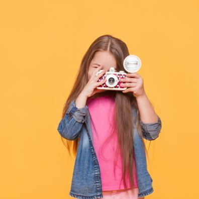 picture of a child holding a camera and taking photos