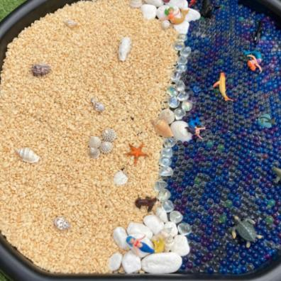 Picture of a beach themed tuff tray activity for kids