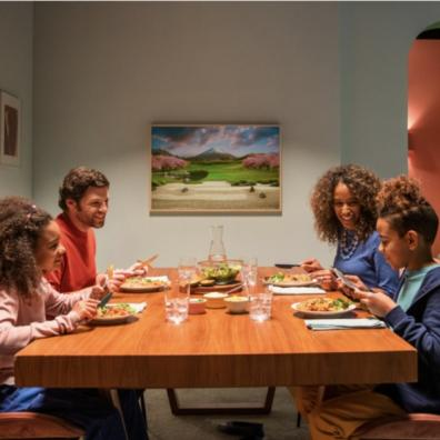 picture of a multi cultural family sitting down to eat dinner together