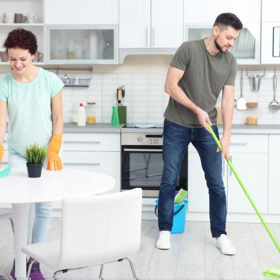 Man and a woman cleaning their kitchen