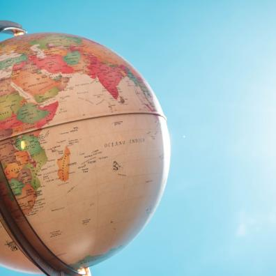 Picture of a world map globe outside in the sunshine