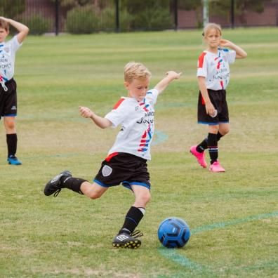 picture of children playing grass roots football