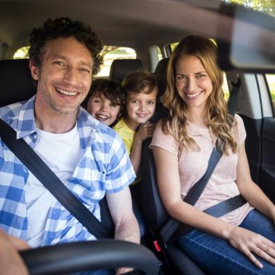 Picture of a family sitting in a car together