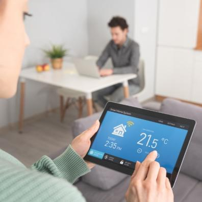 Woman controlling her home energy with a smart device