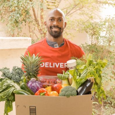 Picture of a man delivering fresh groceries