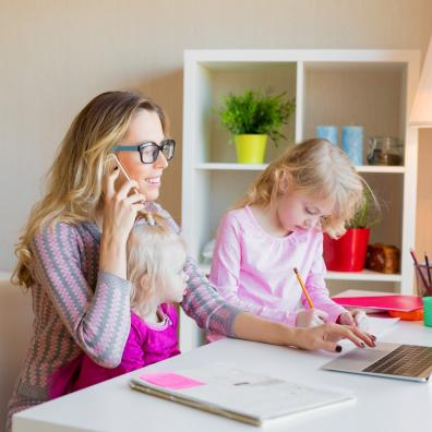 Picture of a mum working from home with two small children