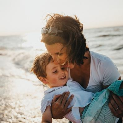 picture of a mum and her son at a sunny beach