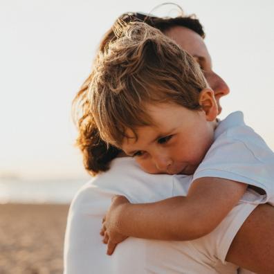 Mum hugging her child