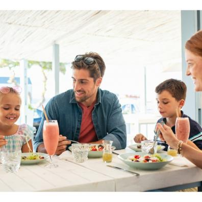 Young family eating out in a restaurant